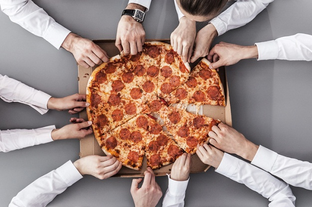 Business team eating pizza